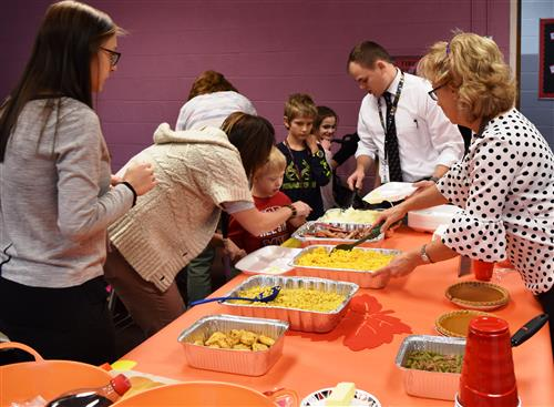 Students enjoy an early holiday meal.